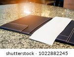 blank empty white paper in... | Shutterstock . vector #1022882245