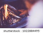 man kindle a fire in the...   Shutterstock . vector #1022884495