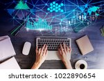 top view of hands using laptop... | Shutterstock . vector #1022890654