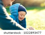 cute little boy with his father ... | Shutterstock . vector #1022893477