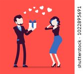 man in love giving gift to... | Shutterstock .eps vector #1022895691