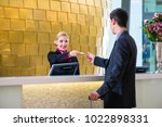 man in hotel check in at... | Shutterstock . vector #1022898331
