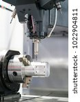 machining precision part by cnc ... | Shutterstock . vector #1022904811