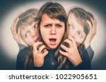 woman with split personality... | Shutterstock . vector #1022905651