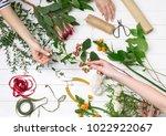female florist making beautiful ... | Shutterstock . vector #1022922067