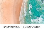 aerial view of waves and beach... | Shutterstock . vector #1022929384