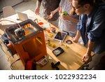 high angle of three creative... | Shutterstock . vector #1022932234