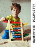preschooler baby learns to... | Shutterstock . vector #1022939599