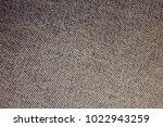 texture of a worn denim | Shutterstock . vector #1022943259