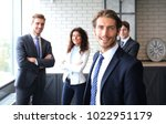 businessman with colleagues in... | Shutterstock . vector #1022951179