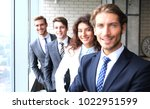 happy smiling business team... | Shutterstock . vector #1022951599