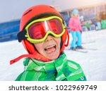 portrait of cute happy skier... | Shutterstock . vector #1022969749