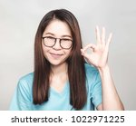 young asian woman with long... | Shutterstock . vector #1022971225