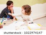 girl is painting  | Shutterstock . vector #1022974147