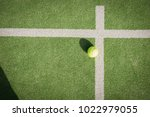 paddle tennis court and ball | Shutterstock . vector #1022979055