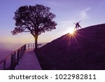 couple silhouette on hill and... | Shutterstock . vector #1022982811