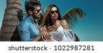 handsome man hugging his woman... | Shutterstock . vector #1022987281