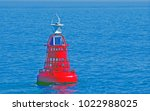 red light buoy floating in the... | Shutterstock . vector #1022988025