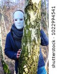 man with white mask hiding... | Shutterstock . vector #1022994541