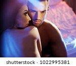 loving couple posing in bedroom.... | Shutterstock . vector #1022995381