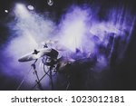 Small photo of silhouette of drummer / percussion / cymbal /drum player playing on drums on a concert . Club lights, fog, smoke, artist show.