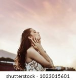 beautiful girl at the beach in... | Shutterstock . vector #1023015601