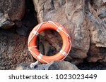 life buoy on volcanic stone | Shutterstock . vector #1023023449
