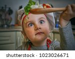little baby as a cook prepares... | Shutterstock . vector #1023026671
