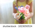 Little Girl With Bouquet Of...