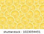 yellow lemon slices pattern... | Shutterstock . vector #1023054451