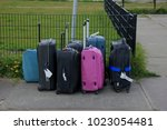 group of small carry on... | Shutterstock . vector #1023054481