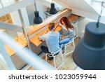 beautiful couple talking in... | Shutterstock . vector #1023059944