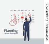 mark calendar. businessman... | Shutterstock .eps vector #1023059974
