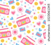seamless pattern with hearts ... | Shutterstock .eps vector #1023061345