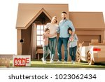 young family on yard of their... | Shutterstock . vector #1023062434