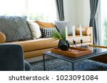 brown leather sofa near a... | Shutterstock . vector #1023091084