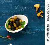 black and green olives in bowl... | Shutterstock . vector #1023107719