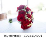 high key bridal bouquet of red... | Shutterstock . vector #1023114001