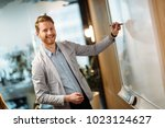 attractive young businessman... | Shutterstock . vector #1023124627