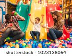 excited little boy playing on a ... | Shutterstock . vector #1023138064