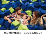 excited young family with their ... | Shutterstock . vector #1023138124