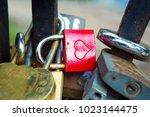 many padlocks of lovers wich... | Shutterstock . vector #1023144475
