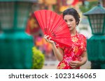 chinese girl wearing red dress... | Shutterstock . vector #1023146065