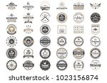 vintage retro vector logo for... | Shutterstock .eps vector #1023156874
