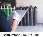 female technician check oxygen ...   Shutterstock . vector #1023158581