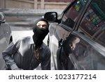 masked burglar wearing a... | Shutterstock . vector #1023177214