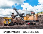 electric rope shovels loading... | Shutterstock . vector #1023187531