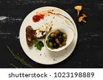 black and green olives in bowl... | Shutterstock . vector #1023198889