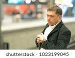 impatient traveler at station... | Shutterstock . vector #1023199045