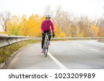 young woman in bright pink... | Shutterstock . vector #1023209989